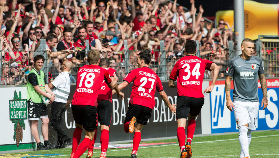 FREIBURG IM BREISGAU, GERMANY - MAY 12: #27 Nicolas Hoefler of Freiburg celebrates after scoring a goal with his teammates during the Bundesliga match between Sport-Club Freiburg and FC Augsburg at Schwarzwald-Stadion on May 12, 2018 in Freiburg im Breisgau, Germany. (Photo by Robert Hradil/Bongarts/Getty Images)