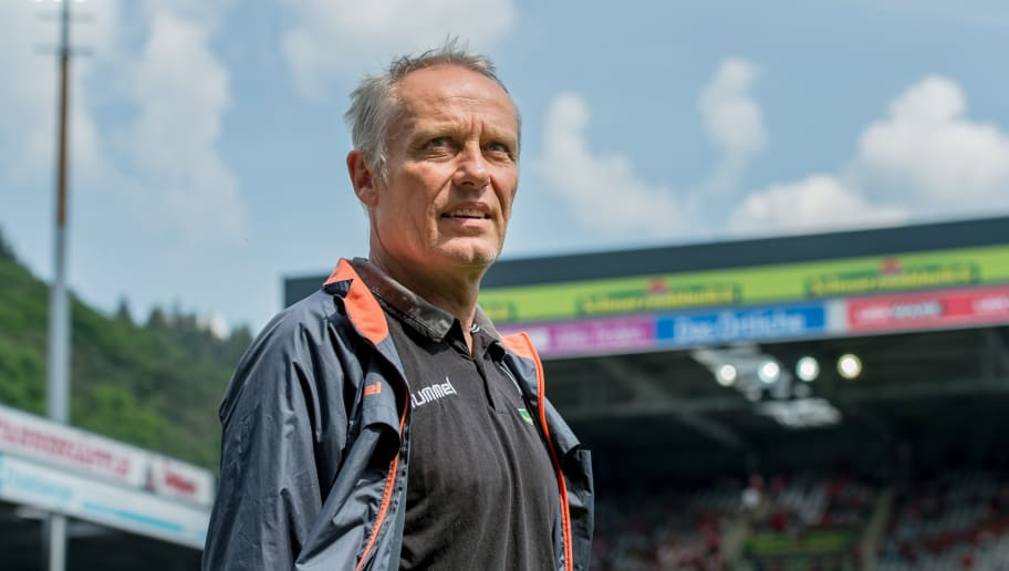 FREIBURG IM BREISGAU, GERMANY - MAY 12: Head Coach Christian Streich of Freiburg looks on during the Bundesliga match between Sport-Club Freiburg and FC Augsburg at Schwarzwald-Stadion on May 12, 2018 in Freiburg im Breisgau, Germany. (Photo by Robert Hradil/Bongarts/Getty Images)