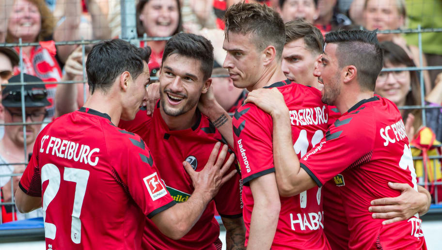 FREIBURG IM BREISGAU, GERMANY - MAY 12: #34 Tim Kleindienst of Freiburg celebrates after scoring a goal during the Bundesliga match between Sport-Club Freiburg and FC Augsburg at Schwarzwald-Stadion on May 12, 2018 in Freiburg im Breisgau, Germany. (Photo by Robert Hradil/Bongarts/Getty Images)