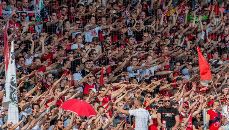 FREIBURG IM BREISGAU, GERMANY - MAY 12: Freiburg fans celebrate the win during the Bundesliga match between Sport-Club Freiburg and FC Augsburg at Schwarzwald-Stadion on May 12, 2018 in Freiburg im Breisgau, Germany. (Photo by Robert Hradil/Bongarts/Getty Images)