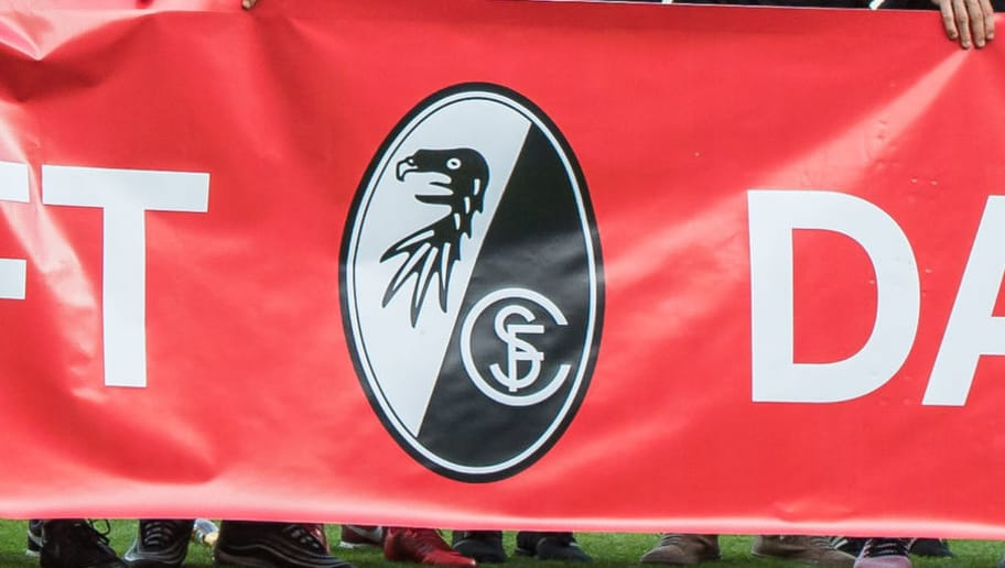 FREIBURG IM BREISGAU, GERMANY - MAY 12: Freiburg team posing with banner for fans during the Bundesliga match between Sport-Club Freiburg and FC Augsburg at Schwarzwald-Stadion on May 12, 2018 in Freiburg im Breisgau, Germany. (Photo by Robert Hradil/Bongarts/Getty Images)