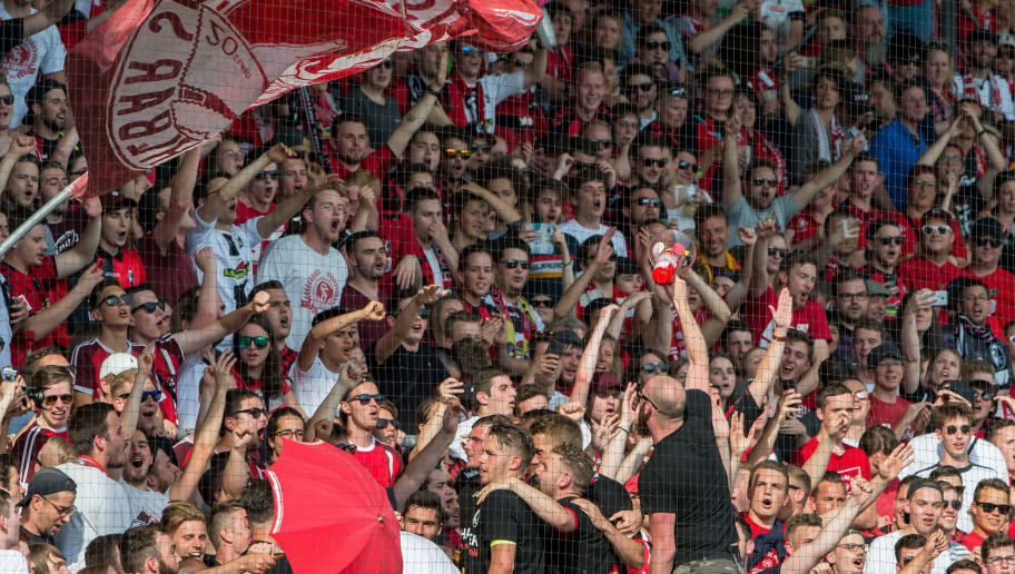FREIBURG IM BREISGAU, GERMANY - MAY 12:  Freiburg fans celebrate the win with fans during the Bundesliga match between Sport-Club Freiburg and FC Augsburg at Schwarzwald-Stadion on May 12, 2018 in Freiburg im Breisgau, Germany. (Photo by Robert Hradil/Bongarts/Getty Images)