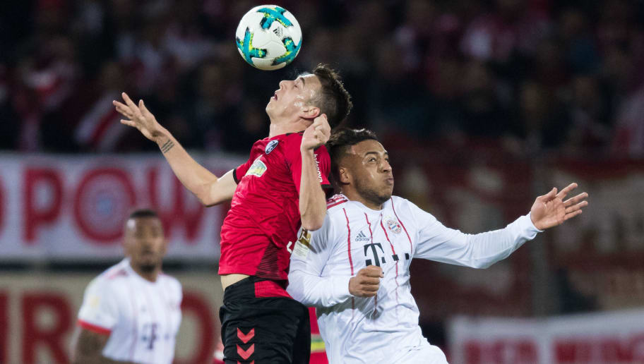 FREIBURG IM BREISGAU, GERMANY - MARCH 04: Janik Haberer of Freiburg jumps for a header with Corentin Tolisso of Muenchen during the Bundesliga match between Sport-Club Freiburg and FC Bayern Muenchen at Schwarzwald-Stadion on March 4, 2018 in Freiburg im Breisgau, Germany. (Photo by Simon Hofmann/Bongarts/Getty Images)