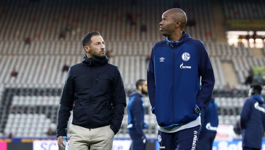 FREIBURG IM BREISGAU, GERMANY - SEPTEMBER 25:  Domenico Tedesco, Manager of FC Schalke 04 and Naldo of FC Schalke 04 inspects the pitch prior to the Bundesliga match between Sport-Club Freiburg and FC Schalke 04 at Schwarzwald-Stadion on September 25, 2018 in Freiburg im Breisgau, Germany.  (Photo by Alex Grimm/Bongarts/Getty Images)