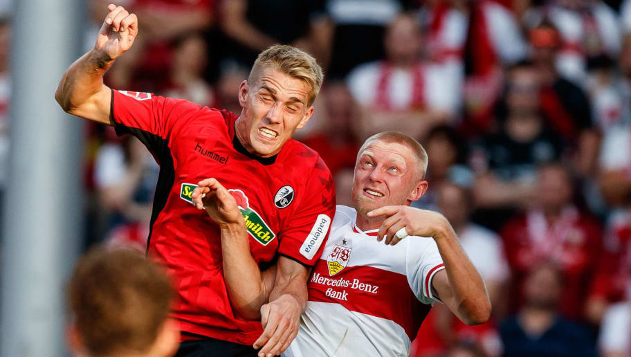 FREIBURG, GERMANY - SEPTEMBER 16: Nils Petersen of Sport-Club Freiburg and Andreas Beck of VfB Stuttgart battle for the ball during the Bundesliga match between Sport-Club Freiburg and VfB Stuttgart on September 16, 2018 in Freiburg, Germany. (Photo by TF-Images/Getty Images)