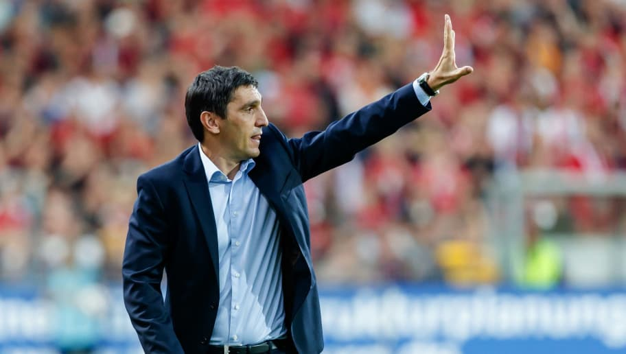FREIBURG, GERMANY - SEPTEMBER 16: Head coach Tayfun Korkut of VfB Stuttgart gestures during the Bundesliga match between Sport-Club Freiburg and VfB Stuttgart on September 16, 2018 in Freiburg, Germany. (Photo by TF-Images/Getty Images)