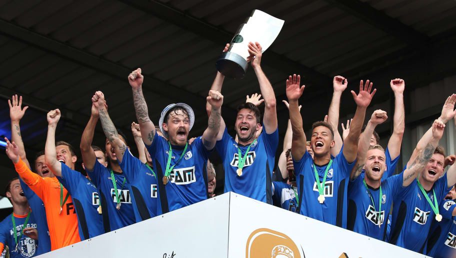 LOTTE, GERMANY - MAY 12:  The team of 1. FC Magdeburg celebrates with the third League trophy after the 3. Liga match between Sportfreunde Lotte and 1. FC Magdeburg at Frimo Stadium on May 12, 2018 in Lotte, Germany. (Photo by Ronny Hartmann/Bongarts/Getty Images)