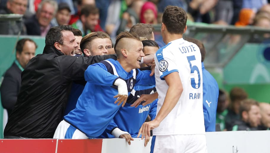 LOTTE, GERMANY - AUGUST 21:  Matthias Rahn of Lotte (R) celebrates scoring the 1:0 goal with teammates during the DFB Cup match between Sportfreunde Lotte and SV Werder Bremen at the Frimo Stadion on August 21, 2016 in Lotte, Germany. (Photo by Mika Volkmann/Bongarts/Getty Images)
