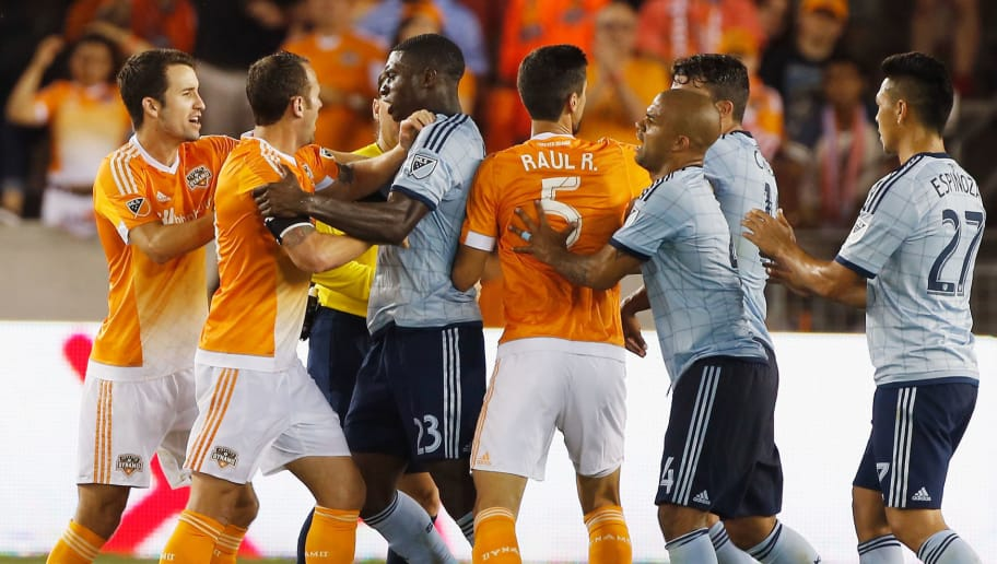 HOUSTON, TX - APRIL 25:  Members of Sporting KC and Houston Dynamo argue on the pitch during their game at BBVA Compass Stadium on April 25, 2015 in Houston, Texas.  (Photo by Scott Halleran/Getty Images)
