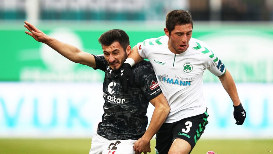 FUERTH, GERMANY - NOVEMBER 26:  Cenk Sahin of FC St. Pauli is challenged by Maximilian Wittek of SpVgg Greuther Fuerth during the Second Bundesliga match between SpVgg Greuther Fuerth and FC St. Pauli at Sportpark Ronhof Thomas Sommer on November 26, 2017 in Fuerth, Germany.  (Photo by Adam Pretty/Bongarts/Getty Images)