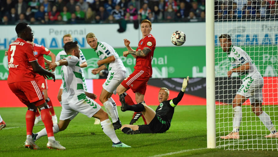 FUERTH, GERMANY - SEPTEMBER 27: David Bates  of Hamburg brings Goalkeeper Sascha Burchert of Fuerth to fall during the Second Bundesliga match between SpVgg Greuther Fuerth and Hamburger SV at Sportpark Ronhof Thomas Sommer on September 27, 2018 in Fuerth, Germany. (Photo by Sebastian Widmann/Bongarts/Getty Images)