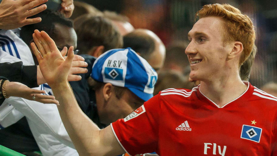 FUERTH, GERMANY - SEPTEMBER 27: David Bates of Hamburg shakes hands with with fans during the Second Bundesliga match between SpVgg Greuther Fuerth and Hamburger SV at Sportpark Ronhof Thomas Sommer on September 27, 2018 in Fuerth, Germany. (Photo by TF-Images/Getty Images)