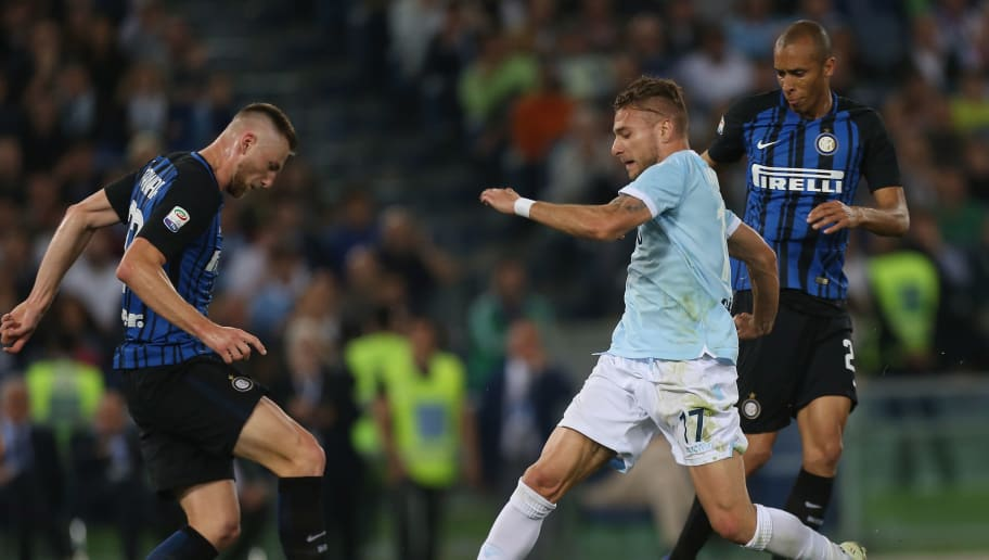 ROME, ITALY - MAY 20: Ciro Immobile of SS Lazio in action against FC Internazionale players during the Serie A match between SS Lazio and FC Internazionale at Stadio Olimpico on May 20, 2018 in Rome, Italy.  (Photo by Paolo Bruno/Getty Images)