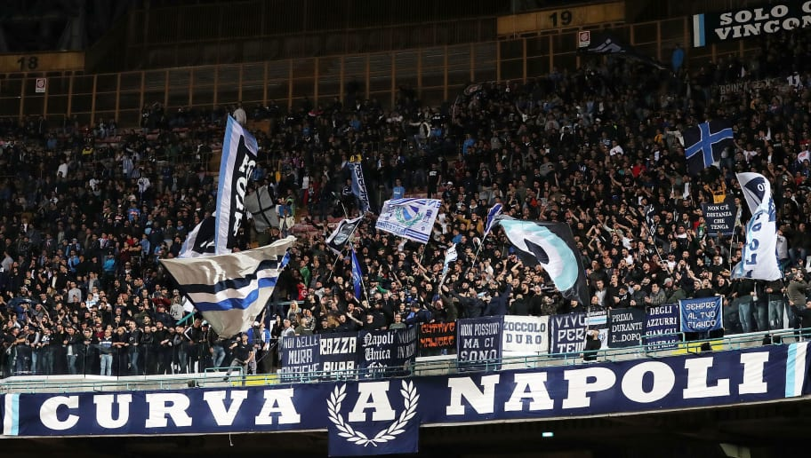 NAPLES, ITALY - NOVEMBER 02: SSC Napoli supporters cheer their team during the Serie A match between SSC Napoli and Empoli at Stadio San Paolo on November 2, 2018 in Naples, Italy.  (Photo by Francesco Pecoraro/Getty Images)