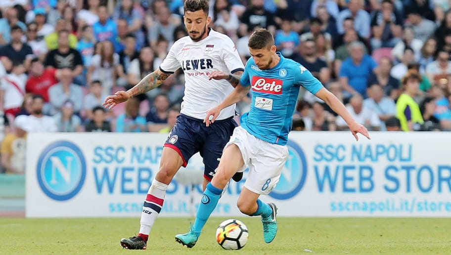 NAPLES, ITALY - MAY 20: Jorginho of SSC Napoli vies with Federico Ceccherini of FC Crotone during the Serie A match between SSC Napoli and FC Crotone at Stadio San Paolo on May 20, 2018 in Naples, Italy.  (Photo by Francesco Pecoraro/Getty Images)