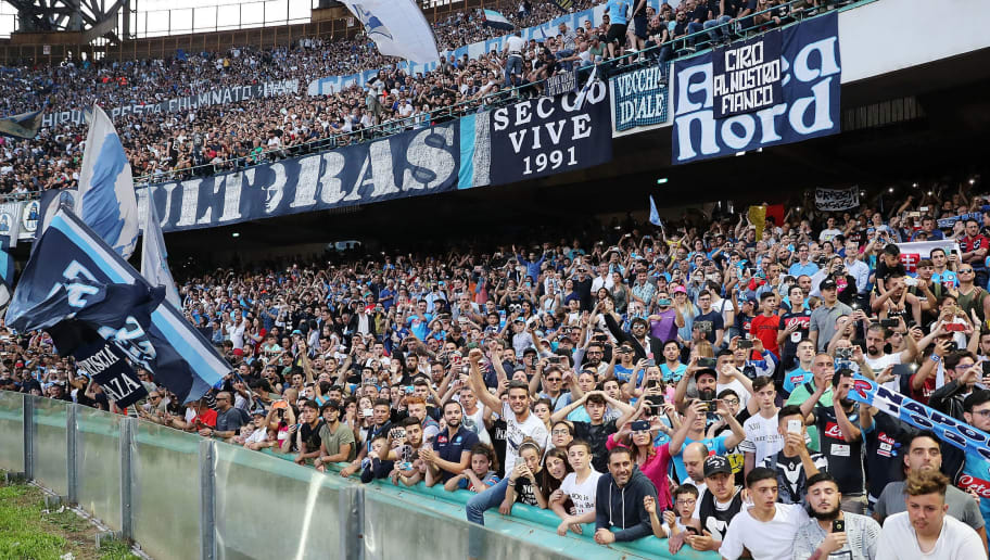 NAPLES, ITALY - MAY 20:  SSC Napoli supporters cheer their team before the Serie A match between SSC Napoli and FC Crotone at Stadio San Paolo on May 20, 2018 in Naples, Italy.  (Photo by Francesco Pecoraro/Getty Images)