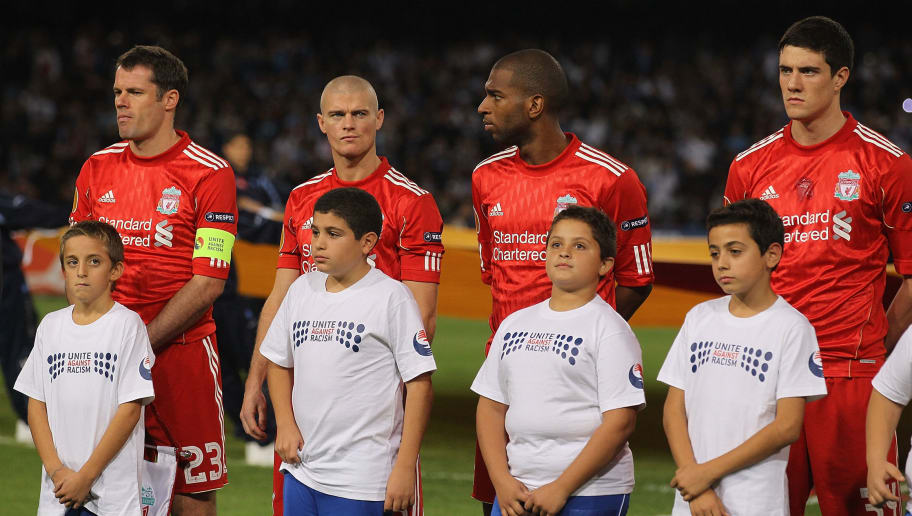 NAPLES, ITALY - OCTOBER 21:  The Liverpool team and mascots line up showing their support for the Unite Against Racism campaign ahead of the UEFA Europa League match between SSC Napoli and Liverpool played at Stadio San Paolo on October 21, 2010 in Naples, Italy.  (Photo by Hamish Blair/Getty Images)