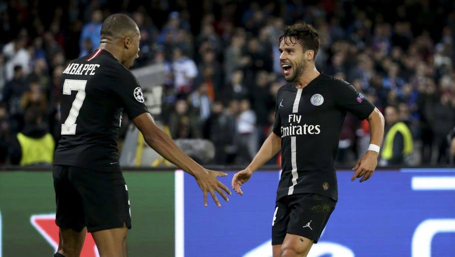 NAPLES, ITALY - NOVEMBER 6: Juan Bernat of PSG celebrates his goal with Kylian Mbappe during the Group C match of the UEFA Champions League between SSC Napoli and Paris Saint-Germain (PSG) at Stadio San Paolo stadium on November 6, 2018 in Naples, Italy. (Photo by Jean Catuffe/Getty Images)
