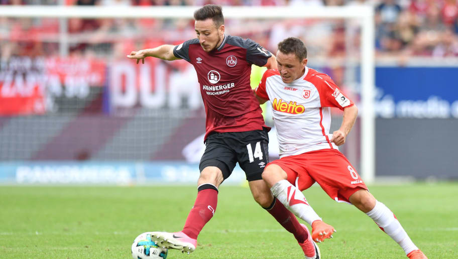 REGENSBURG, GERMANY - AUGUST 06: Kevin Moehwald of 1. FC Nuernberg and Andreas Geipl  of SSV Jahn Regensburg compete for the ball during the Second Bundesliga match between SSV Jahn Regensburg and 1. FC Nuernberg at Continental Arena on August 6, 2017 in Regensburg, Germany. (Photo by Sebastian Widmann/Bongarts/Getty Images)