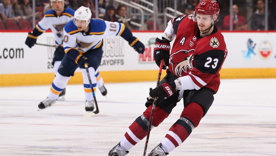 GLENDALE, AZ - MARCH 31:  Oliver Ekman-Larsson #23 of the Arizona Coyotes skates with the puck ahead of Brayden Schenn #10 of the St. Louis Blues during the third period of the NHL game at Gila River Arena on March 31, 2018 in Glendale, Arizona.  The Coyotes defeated the Blues 5-0. (Photo by Christian Petersen/Getty Images)