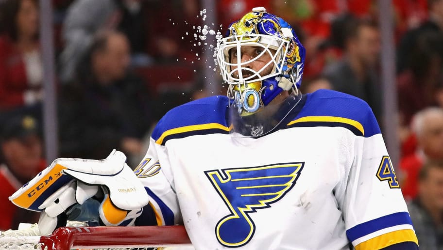 CHICAGO, IL - APRIL 06:  Carter Hutton #40 of the St. Louis Blues spits water during a break against the Chicago Blackhawks at the United Center on April 6, 2018 in Chicago, Illinois. The Blues defeated the Blackhawks 4-1. (Photo by Jonathan Daniel/Getty Images)