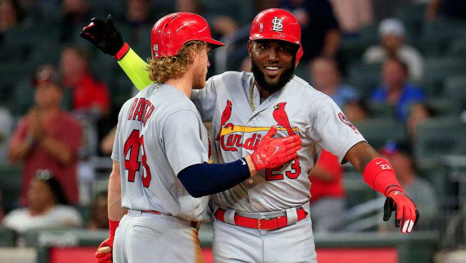 ATLANTA, GA - SEPTEMBER 18: Marcell Ozuna #23 celebrates scoring with Harrison Bader #48 of the St. Louis Cardinals during the eighth inning against the Atlanta Braves at SunTrust Park on September 18, 2018 in Atlanta, Georgia. (Photo by Daniel Shirey/Getty Images)