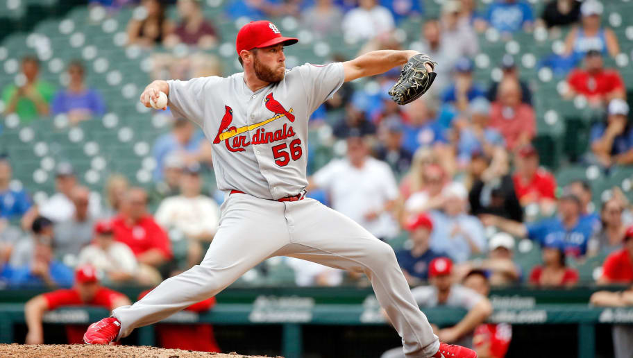 CHICAGO, IL - JULY 20: Greg Holland #56 of the St. Louis Cardinals pitches against the Chicago Cubs during the ninth inning at Wrigley Field on July 20, 2018 in Chicago, Illinois. The St. Louis Cardinals won 18-5. (Photo by Jon Durr/Getty Images)