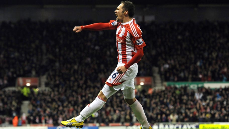 """Stoke City's English midfielder Matthew Etherington celebrates after scoring a goal during the English Premier League football match between Stoke City and Tottenham Hotspur at The Britannia Stadium in Stoke-on-Trent on December 11, 2011. AFP PHOTO/PAUL ELLIS  No use with unauthorized audio, video, data, fixture lists, club/league logos or """"live"""" services. Online in-match use limited to 45 images, no video emulation. No use in betting, games or single club/league/player publications. (Photo credit should read PAUL ELLIS/AFP/Getty Images)"""