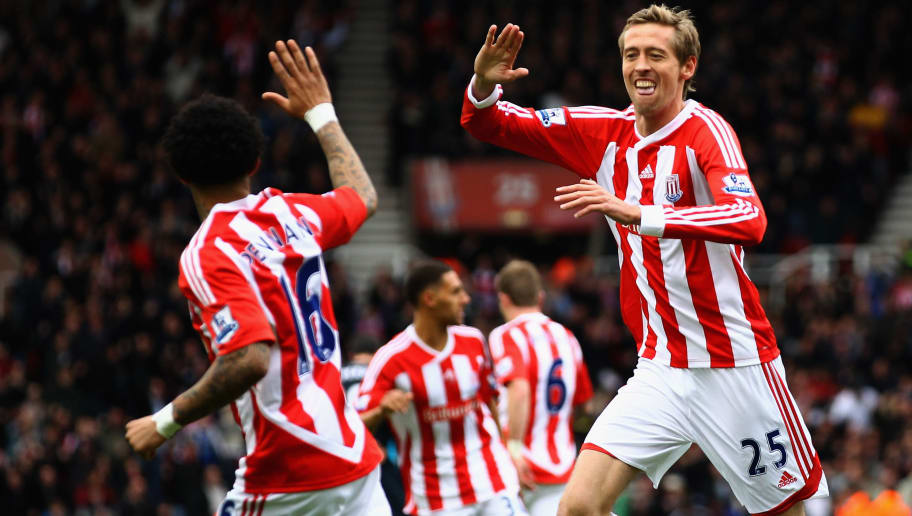 STOKE ON TRENT, ENGLAND - APRIL 28:  Peter Crouch of Stoke City celebrates with Jermaine Pennant after scoring the first goal during the Barclays Premier League match between Stoke City and Arsenal at Britannia Stadium on April 28, 2012 in Stoke on Trent, England.  (Photo by Clive Brunskill/Getty Images)
