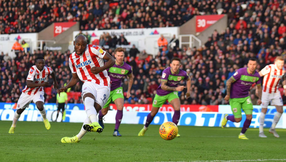 STOKE ON TRENT, ENGLAND - JANUARY 01: Benik Afobe of Stoke City misses a penalty during the Sky Bet Championship match between Stoke City and Bristol City at Bet365 Stadium on January 01, 2019 in Stoke on Trent, England. (Photo by Nathan Stirk/Getty Images)