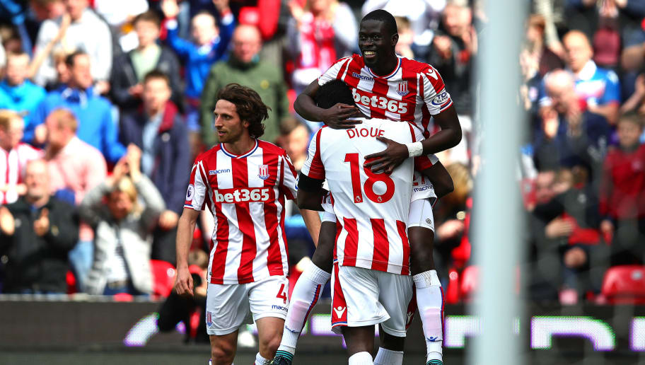 STOKE ON TRENT, ENGLAND - APRIL 22: Badou Ndiaye of Stoke City is congratulated by team-mate Mame Biram Diouf after scoring the opening goal during the Premier League match between Stoke City and Burnley at Bet365 Stadium on April 22, 2018 in Stoke on Trent, England. (Photo by Chris Brunskill Ltd/Getty Images)