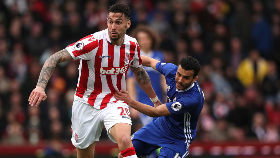 STOKE ON TRENT, ENGLAND - MARCH 18:  Geoff Cameron of Stoke City competes with Pedro of Chelsea during the Premier League match between Stoke City and Chelsea at Bet365 Stadium on March 18, 2017 in Stoke on Trent, England.  (Photo by Matthew Ashton - AMA/Getty Images)