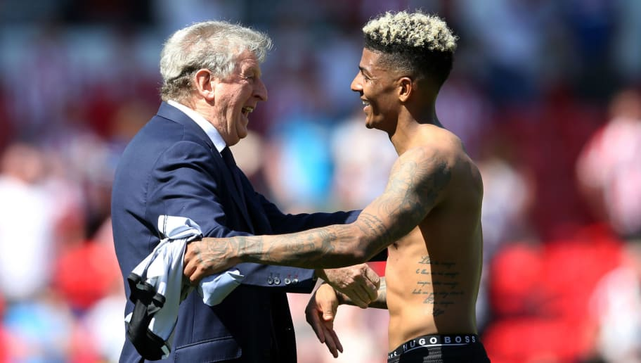 STOKE ON TRENT, ENGLAND - MAY 05:  Roy Hodgson, Manager of Crystal Palace embraces Patrick van Aanholt of Crystal Palace at the full time whistle after the Premier League match between Stoke City and Crystal Palace at Bet365 Stadium on May 5, 2018 in Stoke on Trent, England.  (Photo by Nigel Roddis/Getty Images)