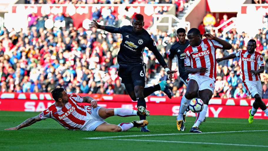 STOKE ON TRENT, ENGLAND - SEPTEMBER 09:  Paul Pogba of Manchester United attempts to shoot as Geoff Cameron of Stoke City (left) and Kurt Zouma of Stoke City attempt to block during the Premier League match between Stoke City and Manchester United at Bet365 Stadium on September 9, 2017 in Stoke on Trent, England.  (Photo by Chris Brunskill Ltd/Getty Images)