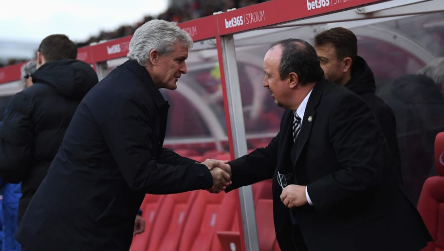 STOKE ON TRENT, ENGLAND - JANUARY 01: Mark Hughes, Manager of Stoke City and Rafael Benitez, Manager of Newcastle United shake hands prior to the Premier League match between Stoke City and Newcastle United at Bet365 Stadium on January 1, 2018 in Stoke on Trent, England.  (Photo by Gareth Copley/Getty Images)
