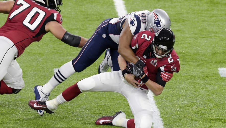 HOUSTON, TX - FEBRUARY 05: Matt Ryan #2 of the Atlanta Falcons gets sacked by Trey Flowers #98 of the New England Patriots during Super Bowl 51 at NRG Stadium on February 5, 2017 in Houston, Texas. The Patriots defeat the Atlanta Falcons 34-28 in overtime. (Photo by Focus on Sport/Getty Images)