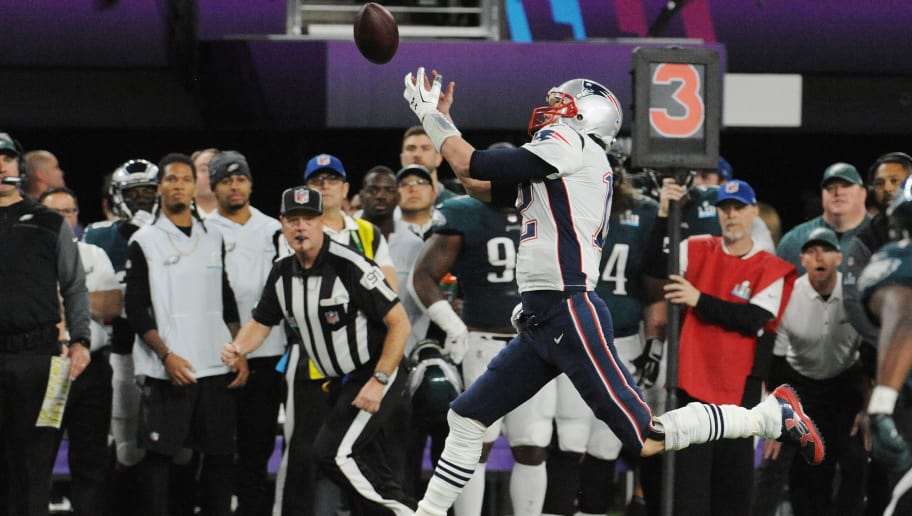 MINNEAPOLIS, MN - FEBRUARY 04:   Tom Brady #12 of the New England Patriots watches the ball go off his finger tips against the Philadelphia Eagles during Super Bowl LII at U.S. Bank Stadium on February 4, 2018 in Minneapolis, Minnesota. The Eagles defeated the Patriots 41-33. (Photo by Focus on Sport/Getty Images) *** Local Caption *** Tom Brady