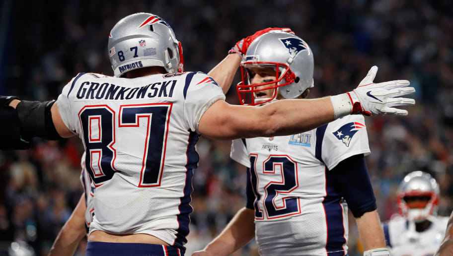 MINNEAPOLIS, MN - FEBRUARY 04: Rob Gronkowski #87 and Tom Brady #12 of the New England Patriots celebrate their 4-yard touchdown pass during the fourth quarter against the Philadelphia Eagles  in Super Bowl LII at U.S. Bank Stadium on February 4, 2018 in Minneapolis, Minnesota.  (Photo by Kevin C. Cox/Getty Images)