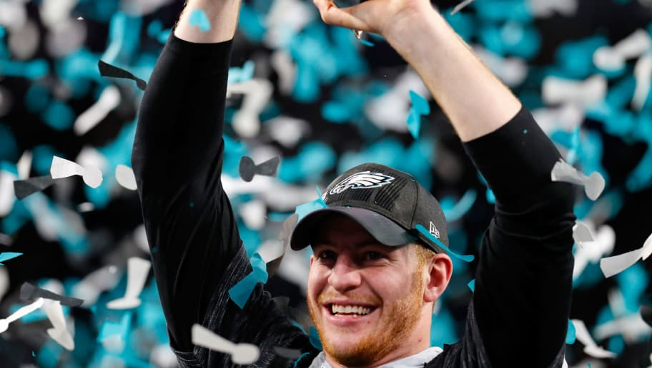 MINNEAPOLIS, MN - FEBRUARY 04:  Carson Wentz #11 of the Philadelphia Eagles celebrates with the Vince Lombardi Trophy after his teams 41-33 victory over the New England Patriots in Super Bowl LII at U.S. Bank Stadium on February 4, 2018 in Minneapolis, Minnesota. The Philadelphia Eagles defeated the New England Patriots 41-33.  (Photo by Kevin C. Cox/Getty Images)