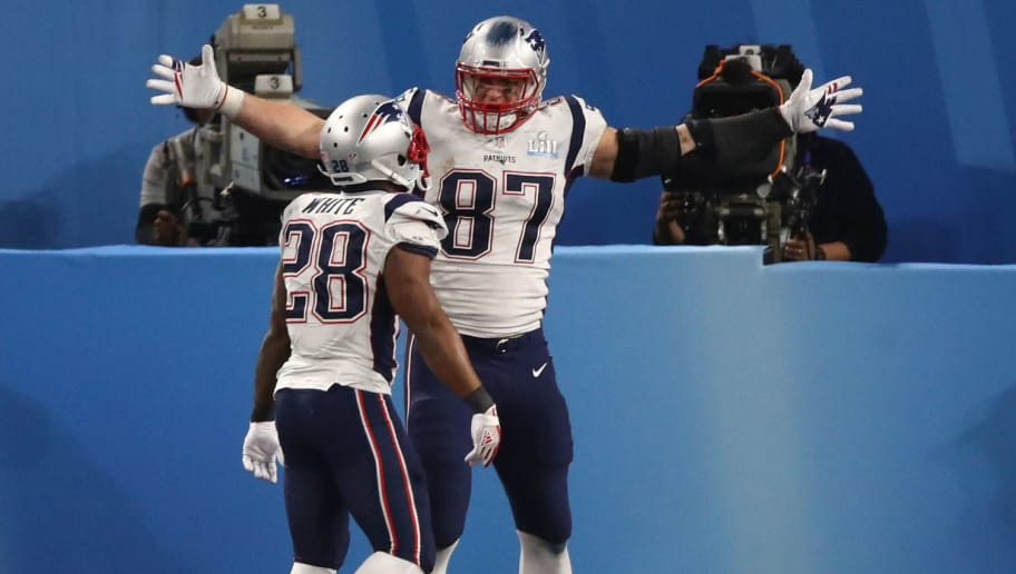 MINNEAPOLIS, MN - FEBRUARY 04:  Rob Gronkowski #87 of the New England Patriots celebrates his four yard touchdown catch with teammates James White #28 during the third quarter against the Philadelphia Eagles in Super Bowl LII at U.S. Bank Stadium on February 4, 2018 in Minneapolis, Minnesota.  (Photo by Gregory Shamus/Getty Images)