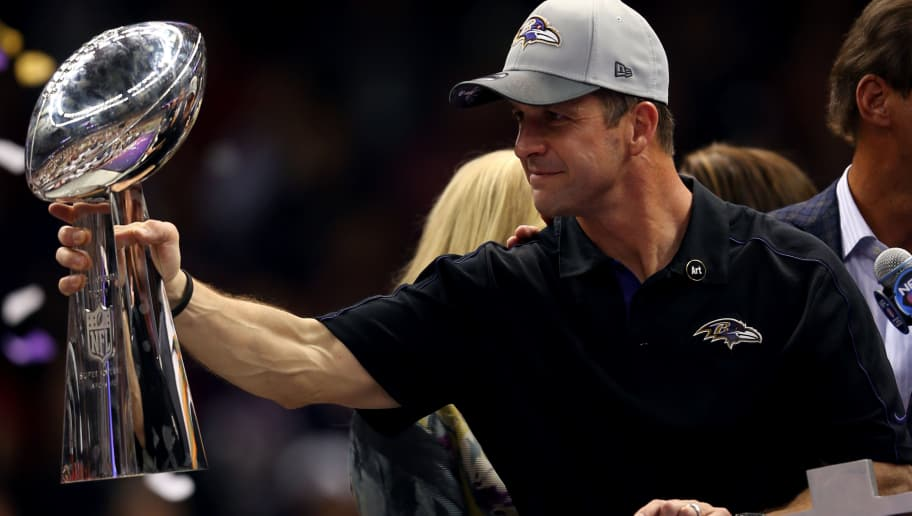 NEW ORLEANS, LA - FEBRUARY 03: Head coach John Harbaugh of the Baltimore Ravens holds up the Vince Lombardi Trophy following their 34-31 win against the San Francisco 49ers during Super Bowl XLVII at the Mercedes-Benz Superdome on February 3, 2013 in New Orleans, Louisiana.  (Photo by Mike Ehrmann/Getty Images)
