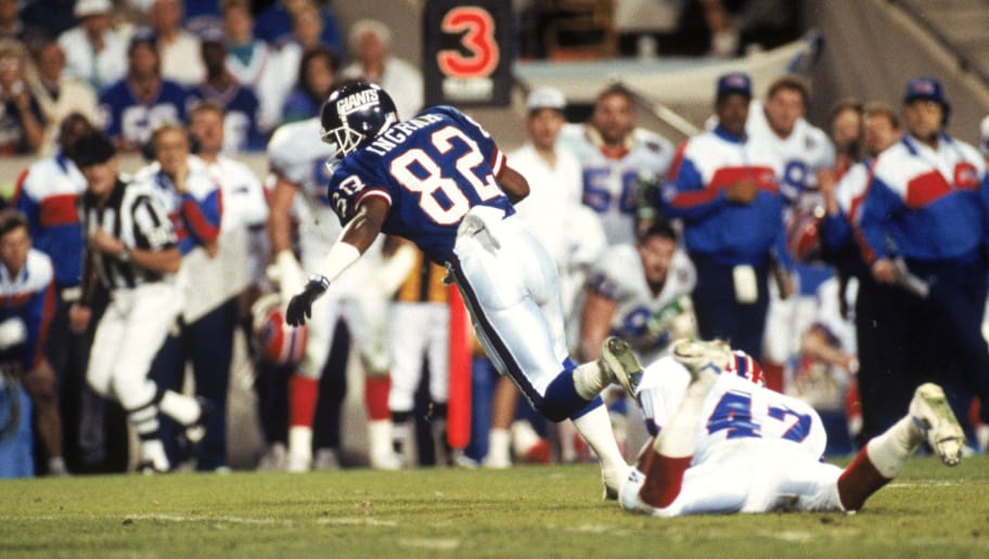 TAMPA, FL - JANUARY 27:  Wide receiver Mark Ingram #82 of the New York Giants runs with a pass reception against the Buffalo Bills during Super Bowl XXV at Tampa Stadium on January 27, 1991 in Tampa, Florida. The Giants defeated the Bills 20-19.  (Photo by George Rose/Getty Images)
