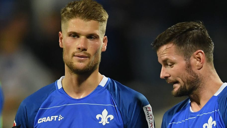 DARMSTADT, GERMANY - OCTOBER 05: Johannes Wurtz of Darmstadt and Marcel Heller of Darmstadt discuss after the Second Bundesliga match between SV Darmstadt 98 and Hamburger SV at Jonathan-Heimes-Stadion am Boellenfalltor on October 5, 2018 in Darmstadt, Germany. (Photo by Matthias Hangst/Bongarts/Getty Images)