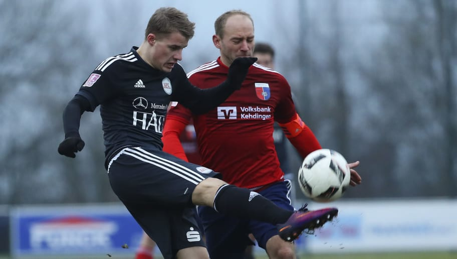 DROCHTERSEN, GERMANY - FEBRUARY 05:  Meikel Klee (R) of Drochtersen and Torben Engelking (L) of  Egetorf competes for the ball during the Regionalliga Nord match SV Drochtersen Assel and 1. FC Germania Egetorf Langreder at the Kehdinger Stadion on February 5, 2017 in Drochtersen, Germany.on February 5, 2017 in Drochtersen, Germany.  (Photo by Oliver Hardt/Bongarts/Getty Images)