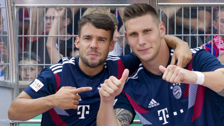 DROCHTERSEN, GERMANY - AUGUST 18: Juan Bernat of Bayern Muenchen and Niklas Suele of Bayern Muenchen gesture prior to the DFB Cup first round match between SV Drochtersen-Assel and Bayern Muenchen at Kehdinger Stadion on August 18, 2018 in Drochtersen, Germany. (Photo by TF-Images/Getty Images)