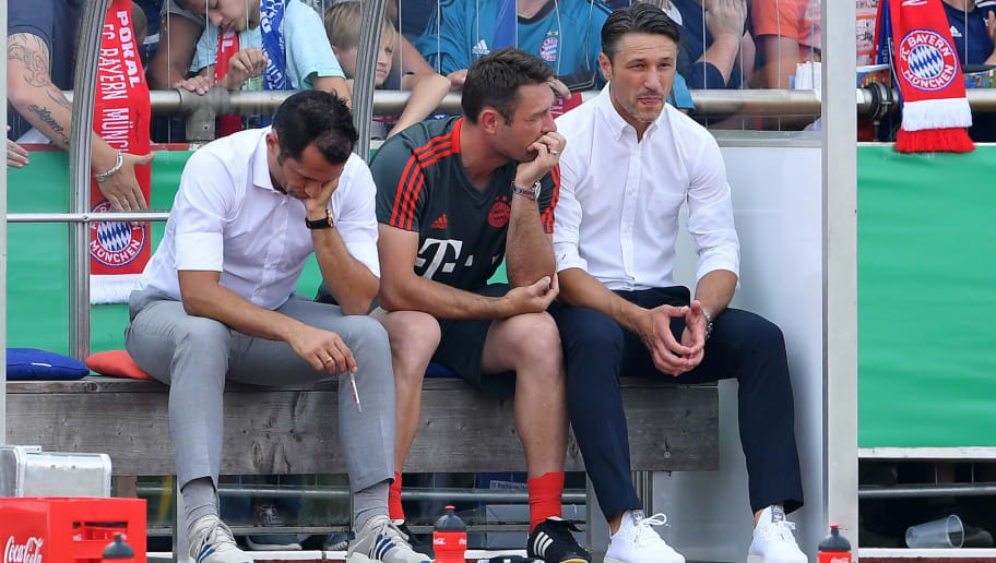 DROCHTERSEN, GERMANY - AUGUST 18:  Hasan Salihamidzic, sports director and Nico Kovac, head coach of Muenchen ponders during the DFB Cup first round match between SV Drochtersen-Assel and Bayern Muenchen on August 18, 2018 in Drochtersen, Germany.  (Photo by Stuart Franklin/Bongarts/Getty Images)
