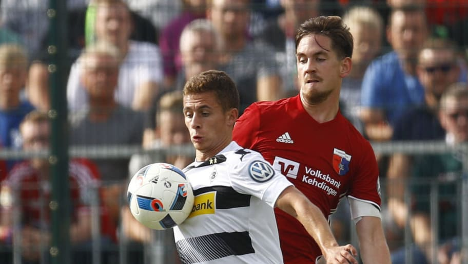 DROCHTERSEN, GERMANY - AUGUST 20: Soeren Behrmann of Drochtersen challenges Thorgan Hazard of Moenchengladbach during the DFB Cup match between SV Drochtersen/Assel and Borussia Moenchengladbach at Kehdinger Stadion on August 20, 2016 in Drochtersen, Germany.  (Photo by Joachim Sielski/Bongarts/Getty Images)