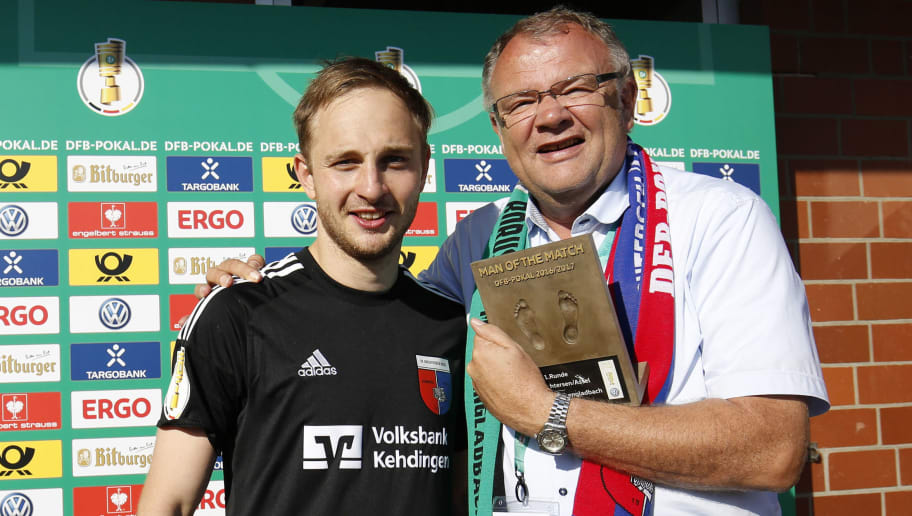 DROCHTERSEN, GERMANY - AUGUST 20: Man of the Match Patrick Siefkes together with Rigo Goossen of Drochtersen after the DFB Cup match between SV Drochtersen/Assel and Borussia Moenchengladbach at Kehdinger Stadion on August 20, 2016 in Drochtersen, Germany.  (Photo by Joachim Sielski/Bongarts/Getty Images)