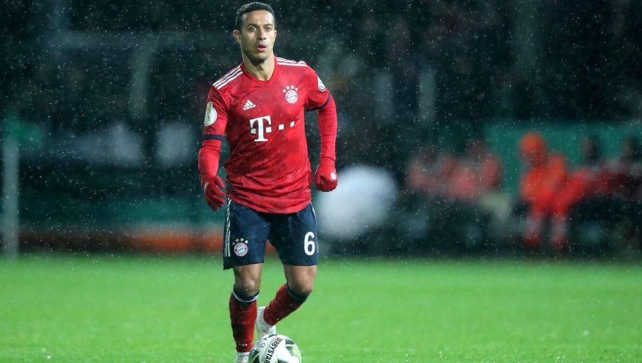 ROEDINGHAUSEN, GERMANY - OCTOBER 30: Thiago of Bayern runs with the ball during the DFB Cup match between SV Rodinghausen and FC Bayern Munich at Hacker-Wiehenstadion on October 30, 2018 in Roedinghausen, Germany. (Photo by Christof Koepsel/Bongarts/Getty Images)