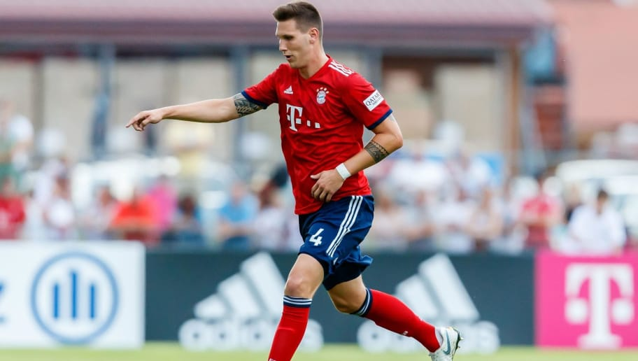 ROTTACH-EGERN, GERMANY - AUGUST 08: Niklas Suele of Bayern Muenchen controls the ball during the friendly match between SV Rottach-Egern and FC Bayern Muenchen on August 8, 2018 in Rottach-Egern, Germany. (Photo by TF-Images/Getty Images)